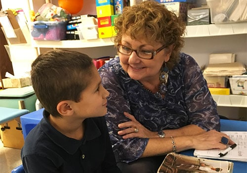 Speech Therapist working with a young man